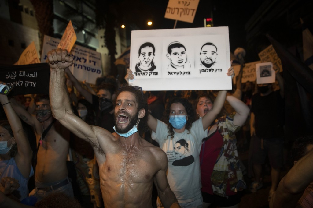 Israelis chant slogans during a protest against corruption near the house of Israel's Minister of Public Security in Tel Aviv, Israel, Tuesday, July 2...
