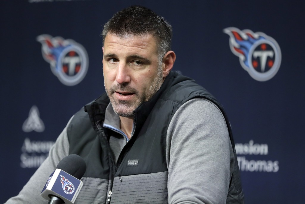 FILE - In this Jan. 20, 2020, file photo, Tennessee Titans head coach Mike Vrabel answers a question during an NFL football news conference in Nashvil...