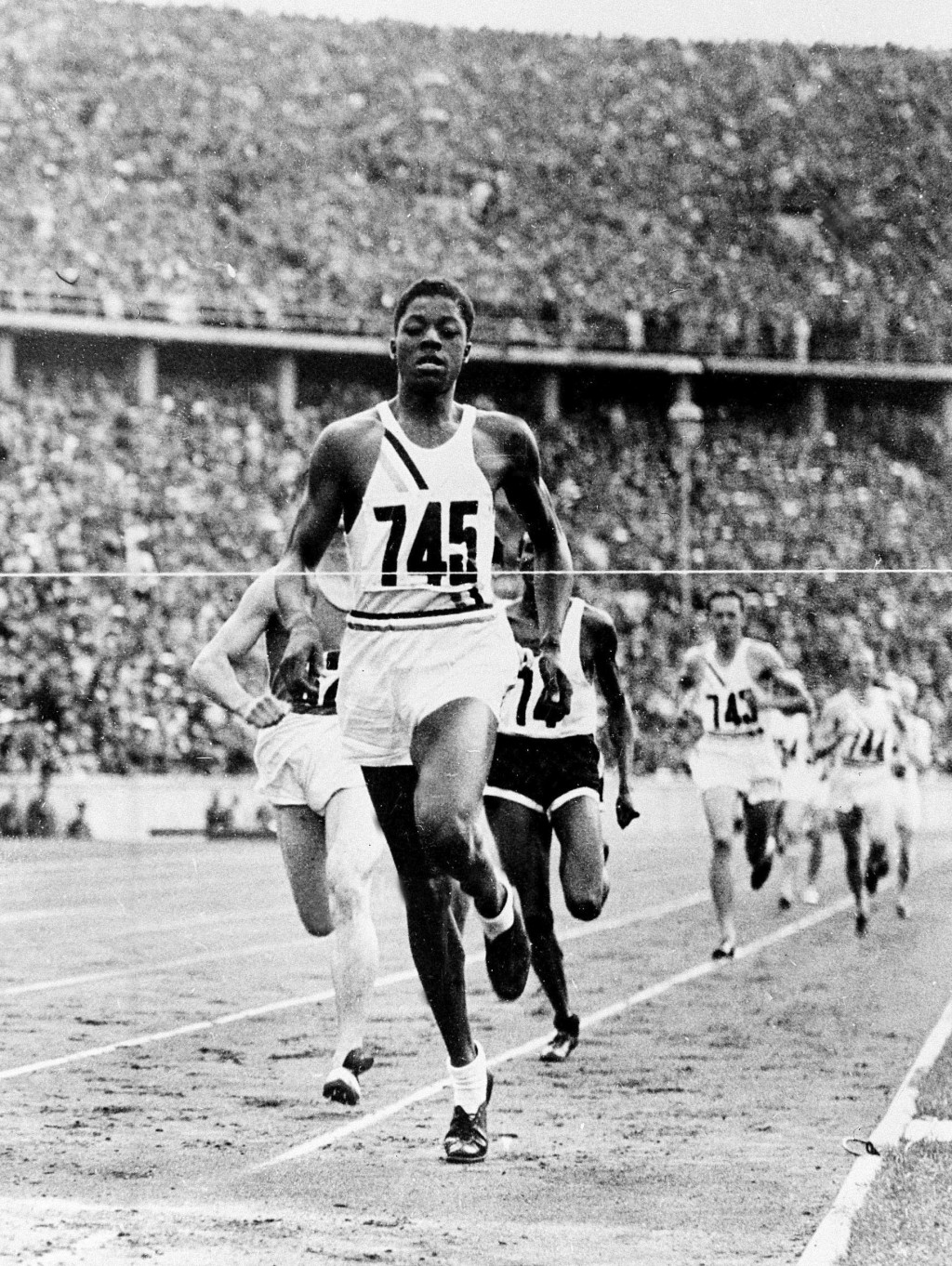 FILE - In this Aug. 8, 1936 file photo, John Woodruff, a freshman at the University of Pittsburgh, wins the 800-meter race at the Olympic Games in Ber...