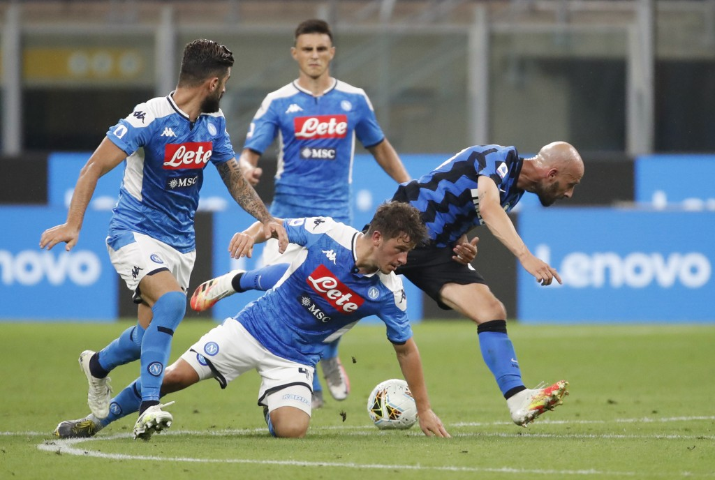 Napoli's Diego Demme, centre, tries to stop Inter Milan's Borja Valero, right, during the Serie A soccer match between Inter Milan and Napoli at the S...
