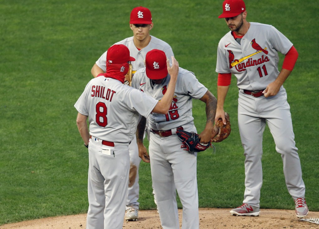 St. Louis Cardinals manager Mike Shildt (8) consoles pitcher Carlos Martinez on the cap as he pulls him following a solo home run by Minnesota Twins' ...