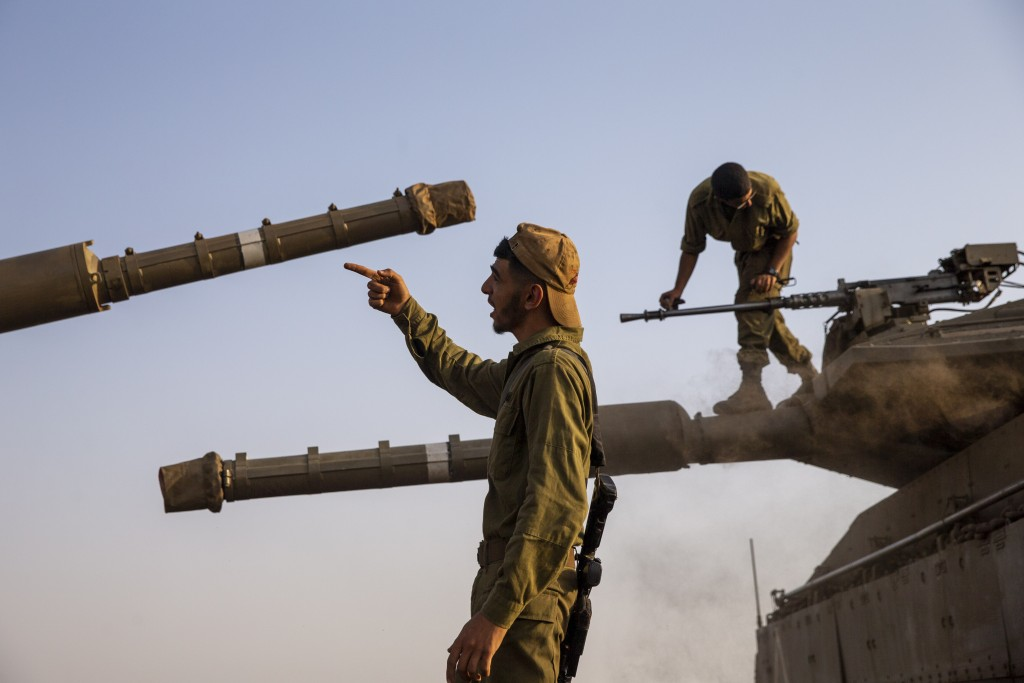 Israeli soldiers work on tanks in the Israeli controlled Golan Heights near the border with Syria, not far from Lebanon border, Tuesday, July 28, 2020...