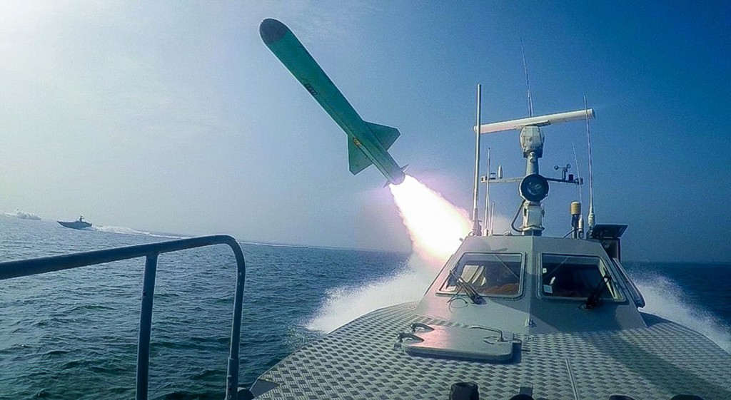 In this photo released Tuesday, July 28, 2020, by Sepahnews, a Revolutionary Guard's speed boat fires a missile during a military exercise. Iranian co...