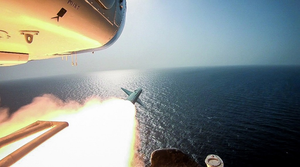 In this photo released Tuesday, July 28, 2020, by Sepahnews, Revolutionary Guard's helicopter fires a missile during an exercise. Iran's paramilitary ...