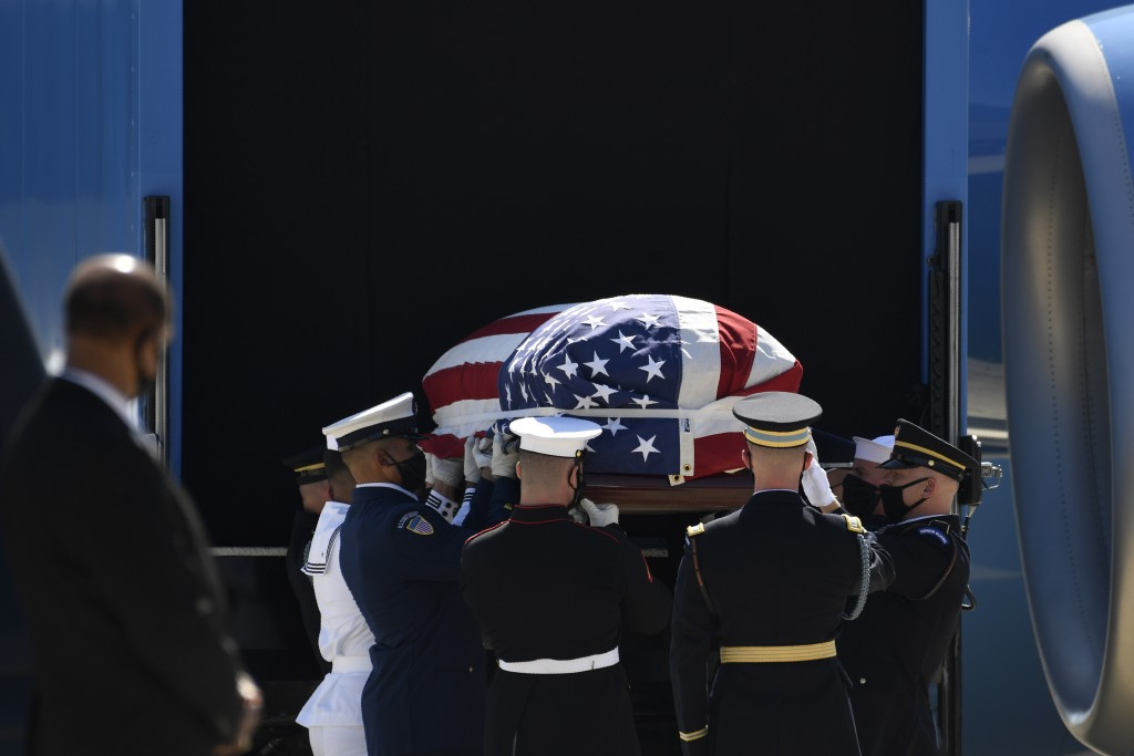 The flag-draped casket of the late Rep. John Lewis, D-Ga., is carried by a joint services military honor guard at Andrews Air Force Base in Md., Wedne...