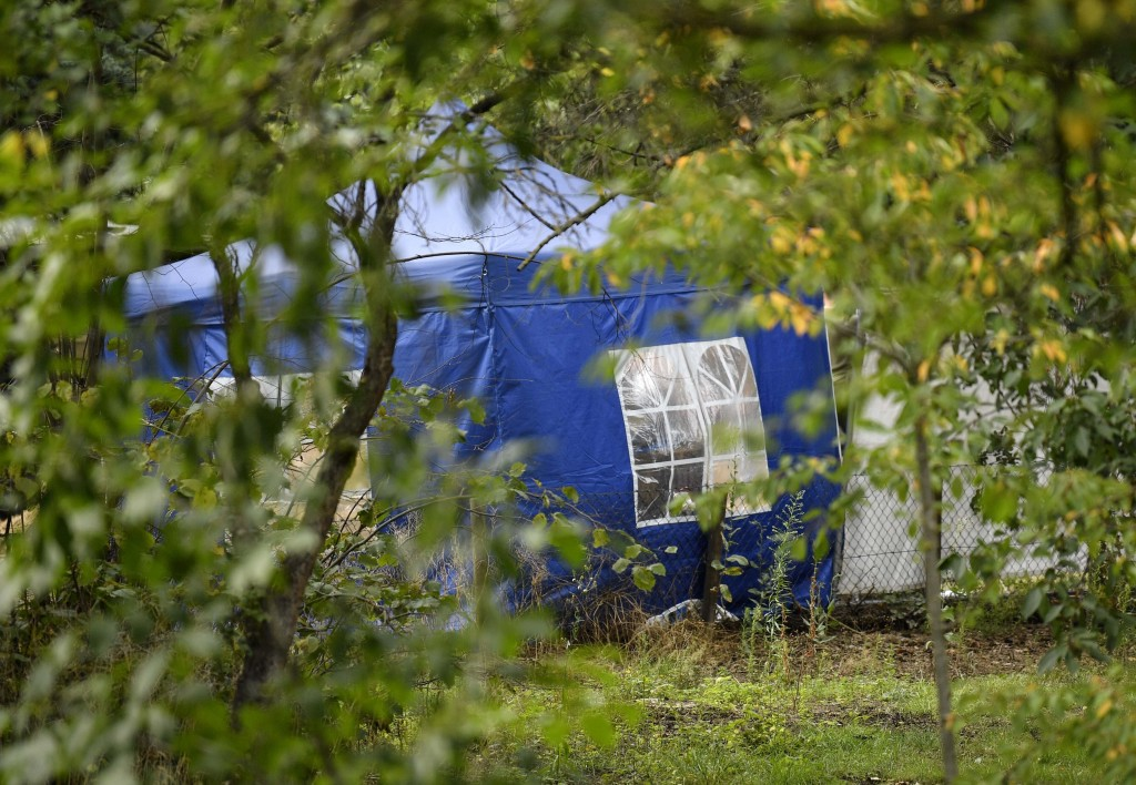 A police tent during the investigation at an allotment garden plot in Seelze, near Hannover, Germany, Tuesday July 28, 2020. Police have begun searchi...