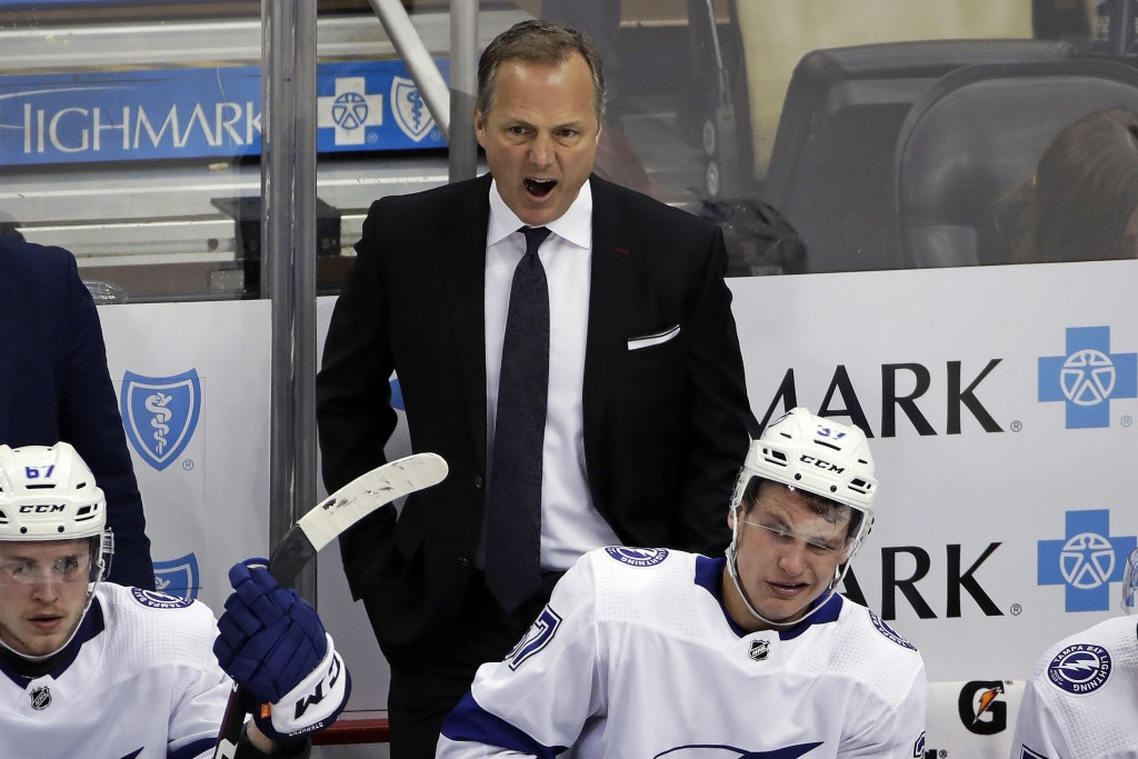 FILE - In this Feb. 11, 2020, file photo, Tampa Bay Lightning head coach Jon Cooper yells instructions during the third period of an NHL hockey game a...