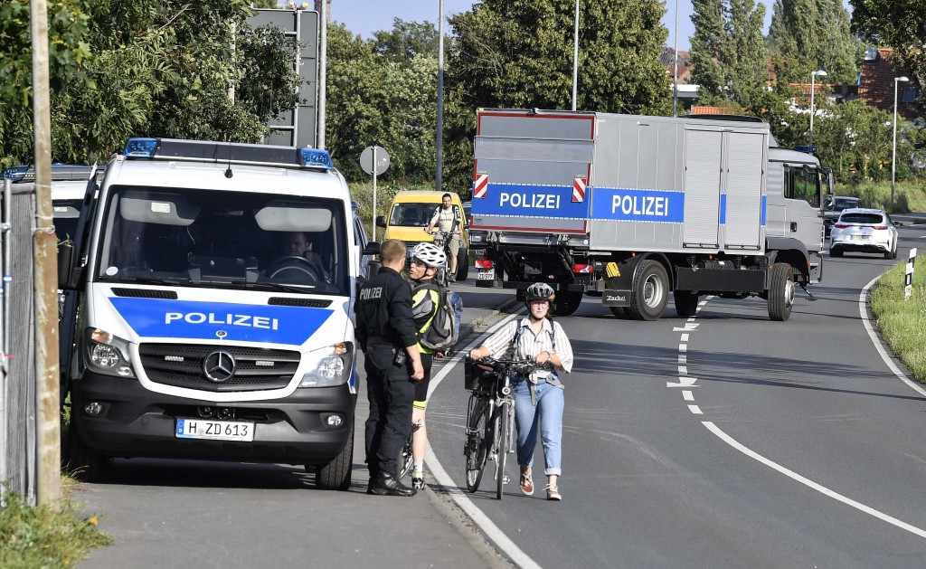 German police officers attend the scene of a search at an allotment garden plot in Seelze, near Hannover, Germany, Tuesday July 28, 2020. Police have ...