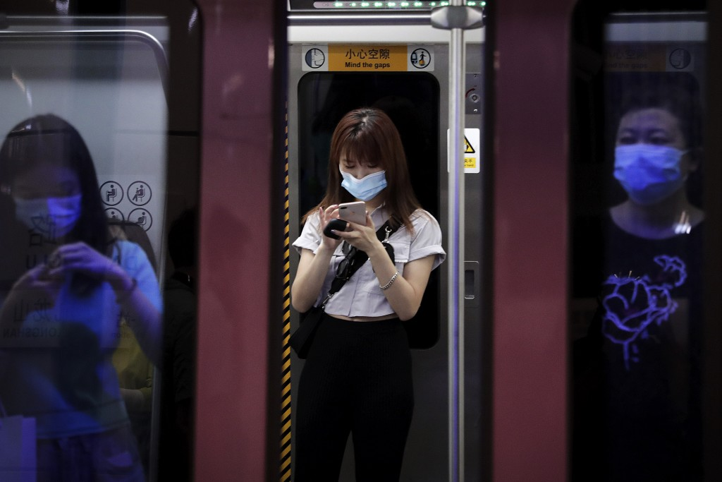 Commuters wearing face masks to protect against the new coronavirus ride in a subway train in Beijing, Wednesday, July 29, 2020. China reported more t...