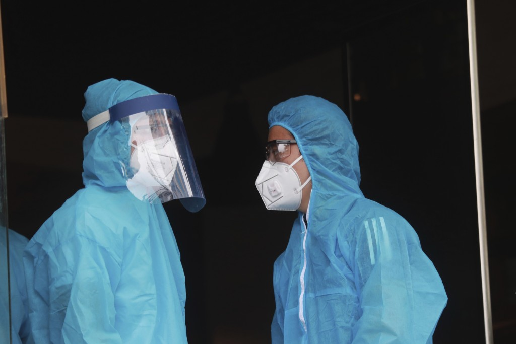 Health workers inspect a restaurant where a worker is suspected to have COVID-19 in Hanoi, Vietnam on Wednesday, July 29, 2020. Vietnam intensifies pr...