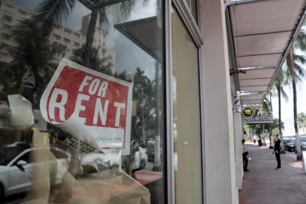 FILE - In this July 13, 2020 file photo, a For Rent sign hangs on a closed shop during the coronavirus pandemic in Miami Beach, Fla.  Having endured w...