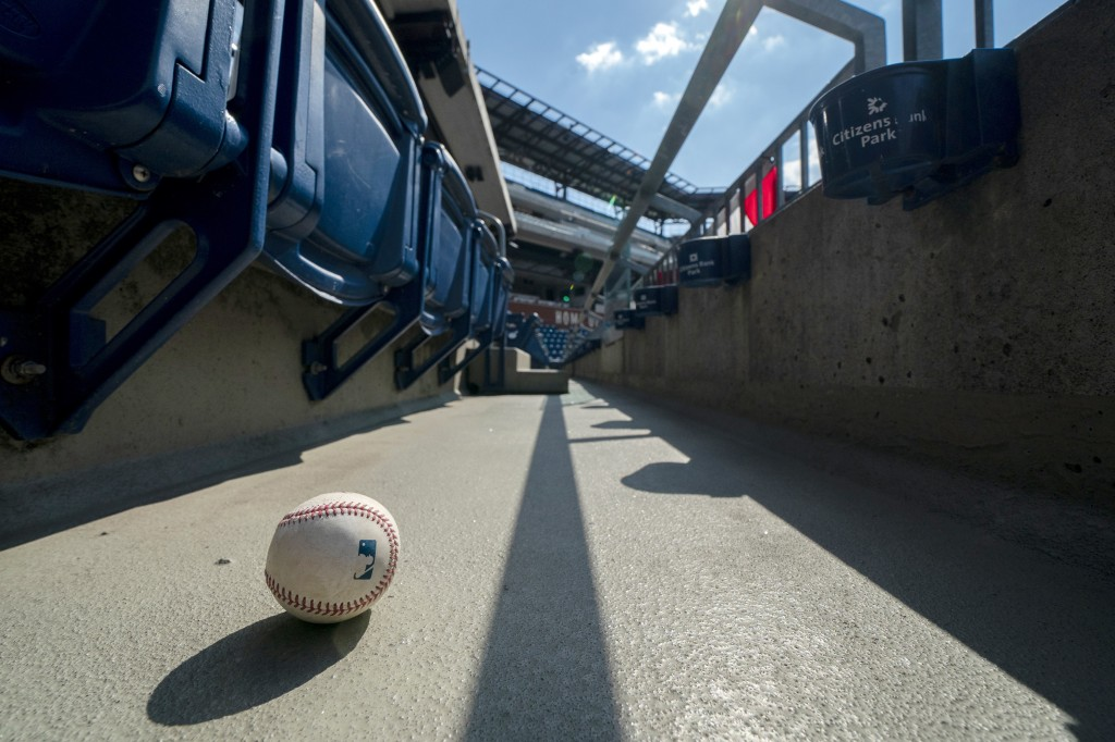 FILE - In this Sunday, July 26, 2020, file photo, a foul ball that was hit into the stands sits on the ground of an empty stadium during the eighth in...