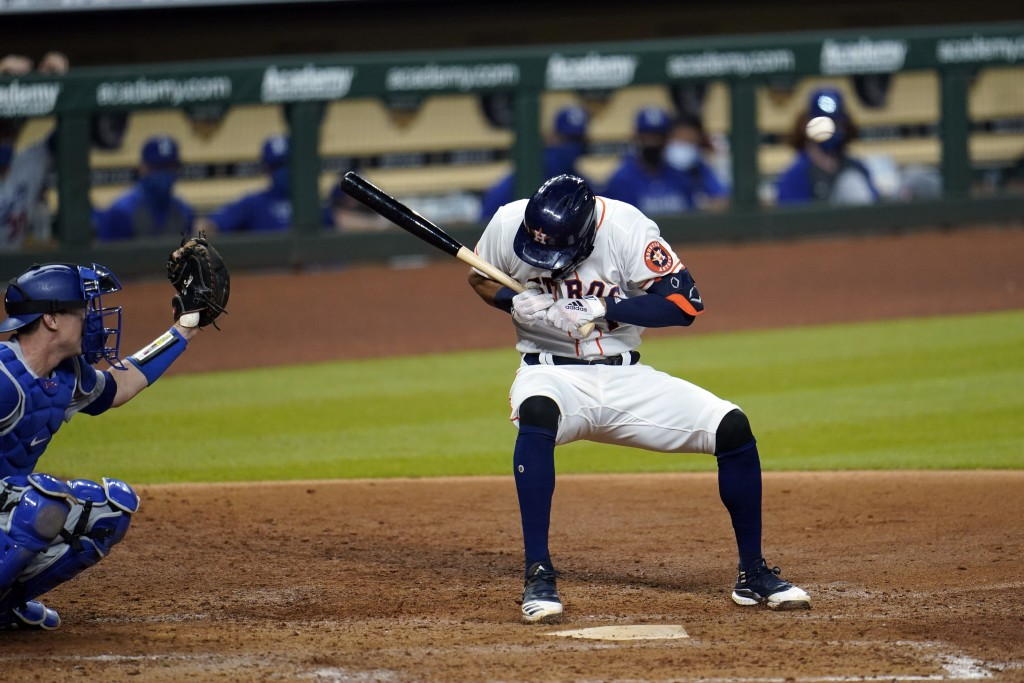 Houston Astros' Carlos Correa, right, ducks from a pitch thrown by Los Angeles Dodgers relief pitcher Joe Kelly as catcher Will Smith reaches for the ...