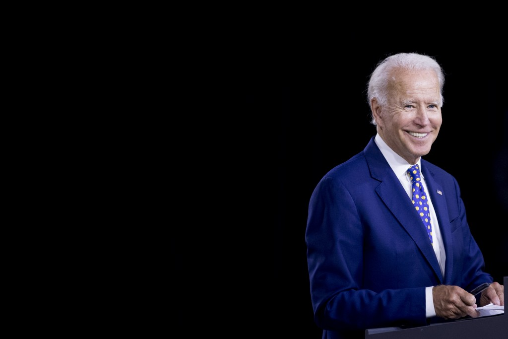 """Democratic presidential candidate former Vice President Joe Biden smiles at a campaign event at the William """"Hicks"""" Anderson Community Center in Wilmi..."""