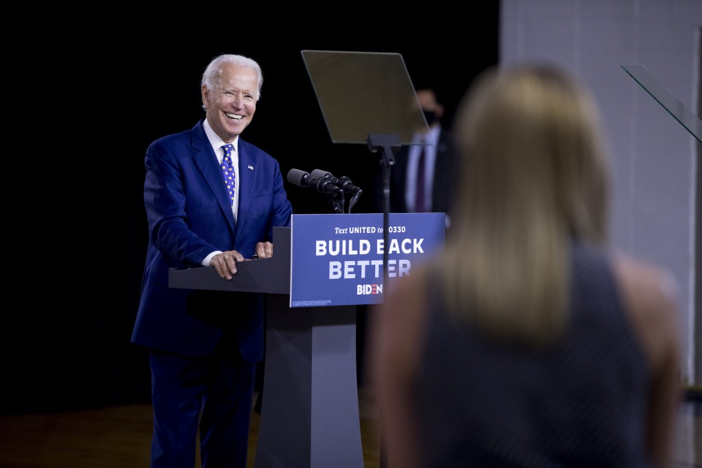 "Democratic presidential candidate former Vice President Joe Biden smiles as he takes a question from a reporter at a campaign event at the William ""Hi..."