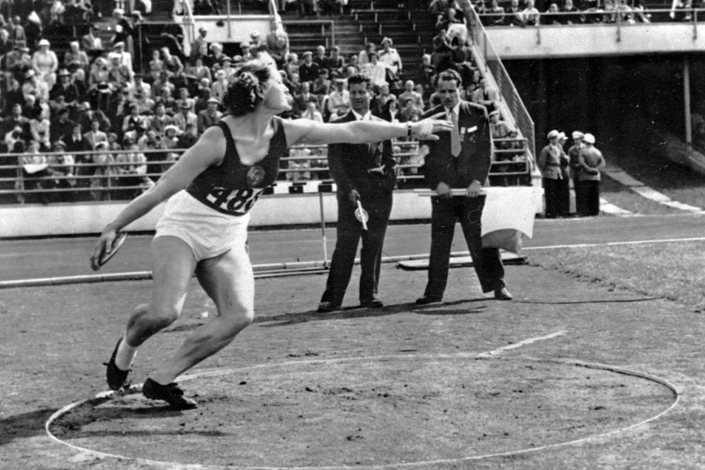 FILE - In this July 1952, file photo, Nina Romashkova, who won the first gold medal for the Soviets in the women's discus competition, winds up to thr...