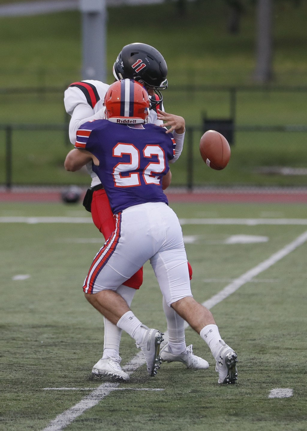 In this image provided by Hobart and William Smith Colleges, Hobart linebacker Emmett Forde knocks the ball loose as he sacks RPI quarterback George M...