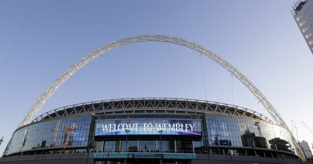 FILE - This Oct. 3, 2018 file photo shows a view of the exterior of Wembley Stadium in London. Supporters will attend soccer in Britain on Friday, Jul...