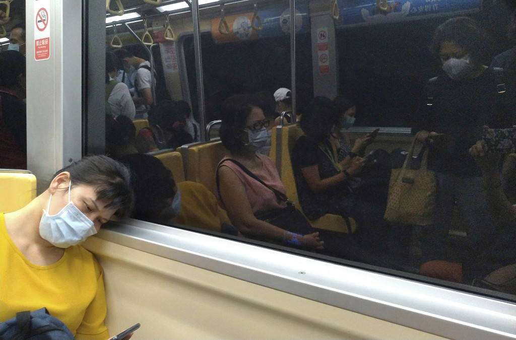 People riding the subway wear face masks to protect against the spread of the coronavirus in Taipei, Taiwan, Thursday, July 30, 2020. (AP Photo/Chiang...