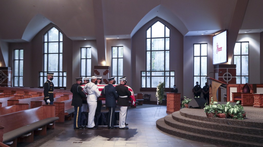 Members of an Honor Guard place the casket of the late Rep. John Lewis, D-Ga., for the funeral service at Ebenezer Baptist Church in Atlanta, Thursday...