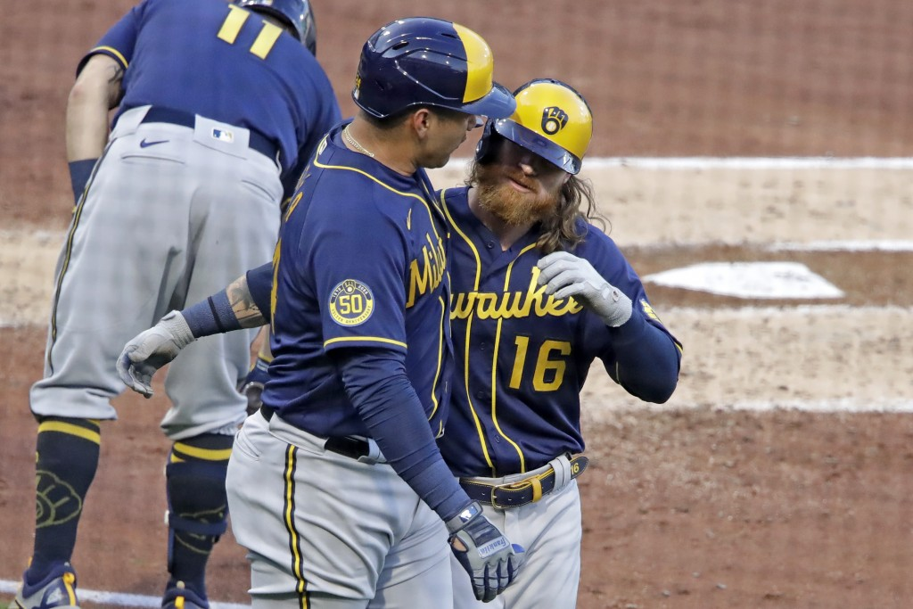 Milwaukee Brewers' Ben Gamel, right, celebrates with Avisail Garcia after hitting a two-run home run off Pittsburgh Pirates starting pitcher Joe Musgr...