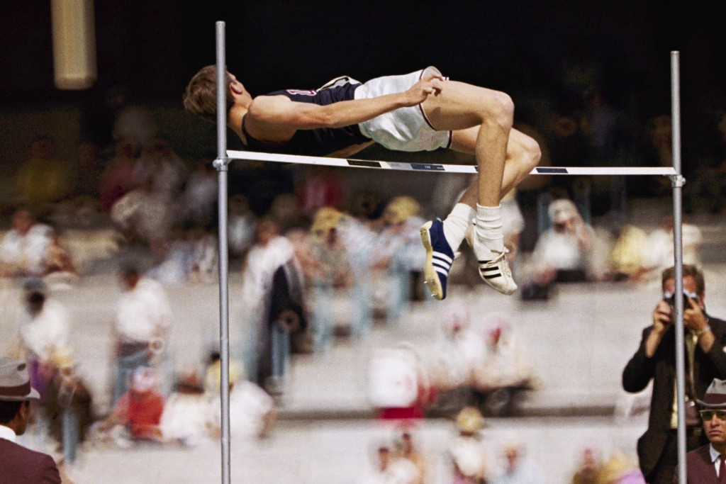 FILE - In this 1968 file photo, Dick Fosbury, of the United States, clears the bar in the high jump competition at the 1968 Mexico City Olympics. Fosb...