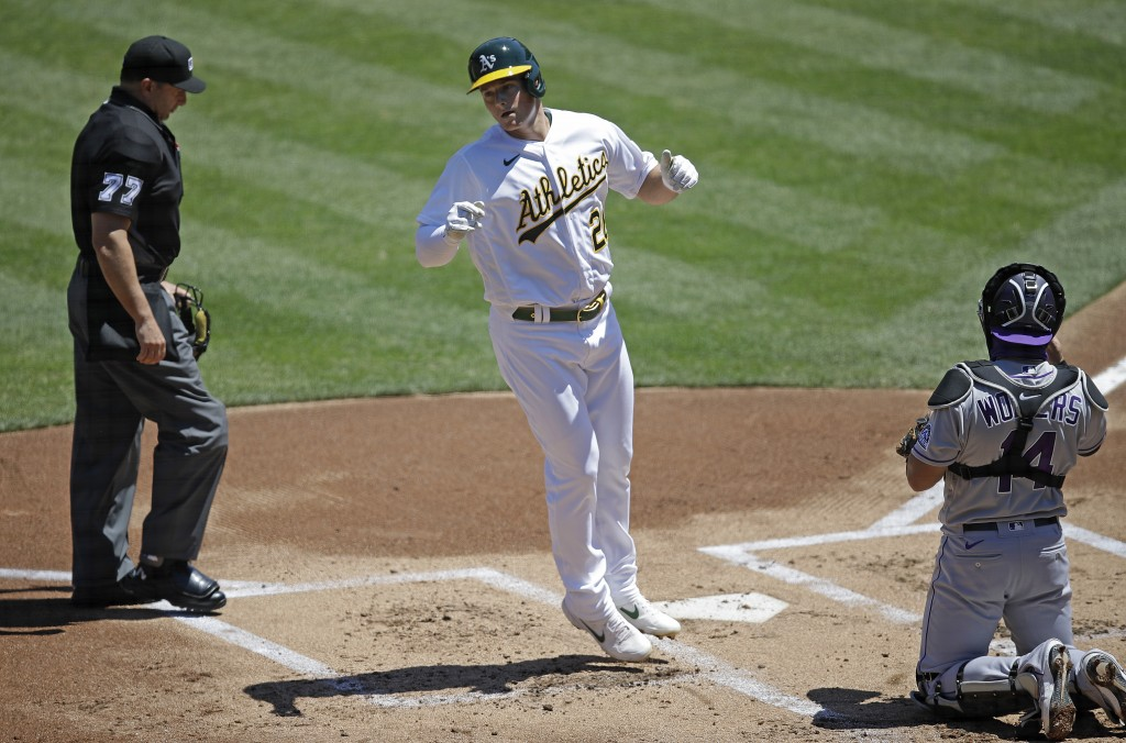 Oakland Athletics' Matt Chapman steps off home plate after hitting a home run off Colorado Rockies pitcher German Marquez in the first inning of a bas...