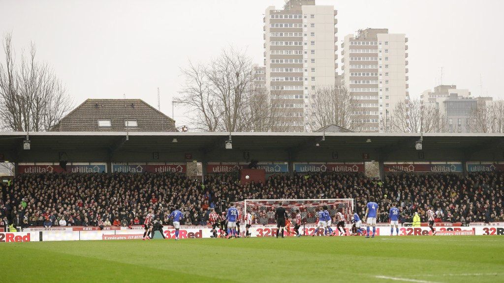 FILE - In this Saturday, Jan. 25, 2020 file photo, spectators watch from the stands of Griffin Park stadium, inaugurated in 1904, during the English F...