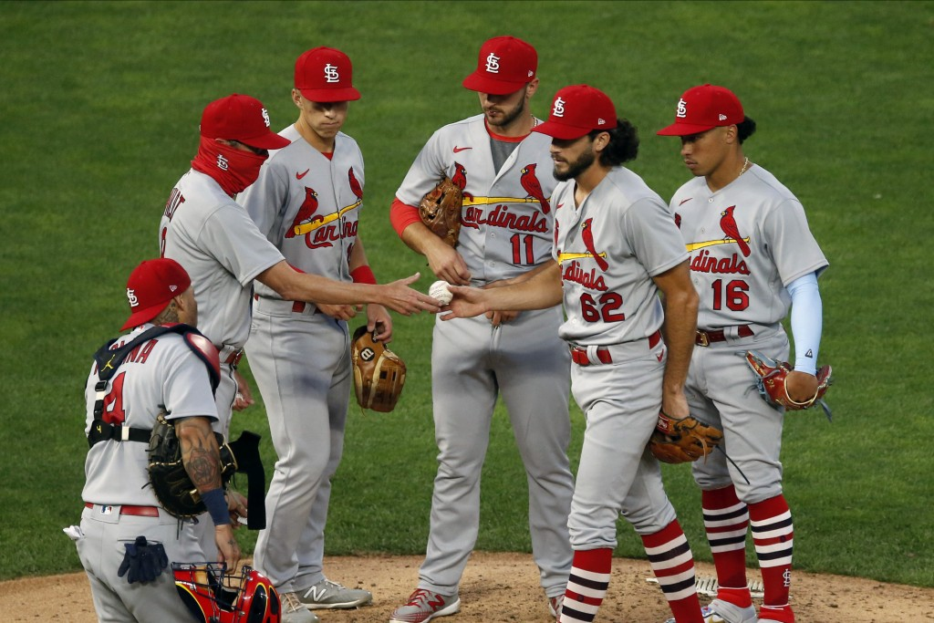 St. Louis Cardinals pitcher Daniel Ponce de Leon hands the ball over to manager Mike Shildt, left, after being pulled in the fifth inning of the team'...