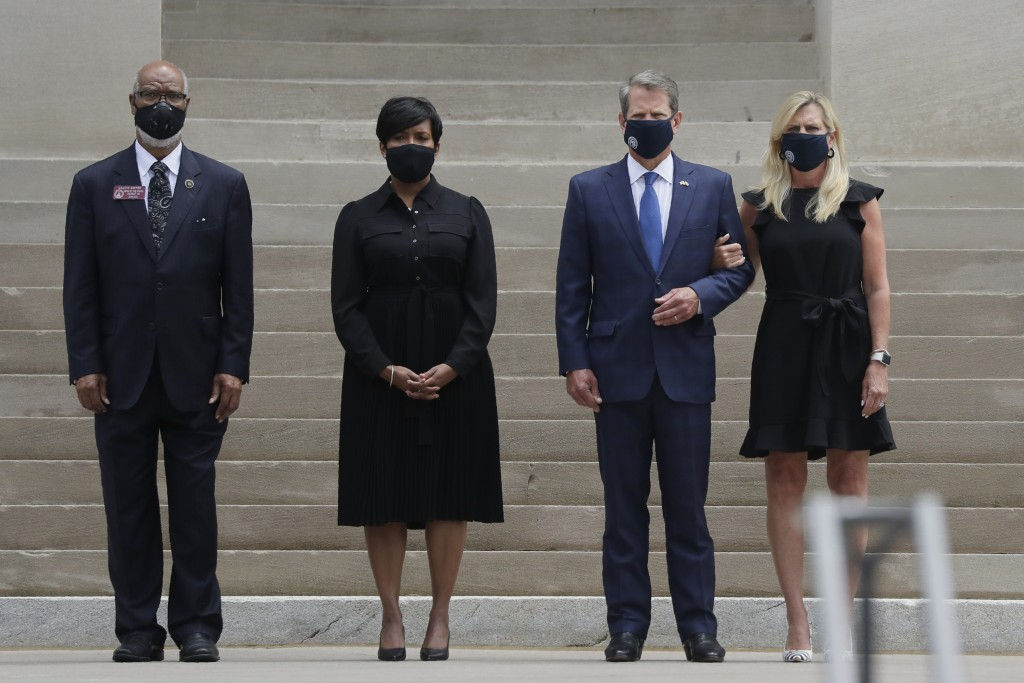 Georgia Gov. Brian Kemp, second from right, his wife Marty Kemp, right, and Atlanta Mayor Keisha Lance Bottoms, second from left, await the casket of ...