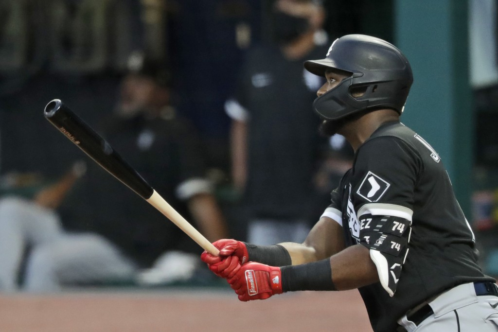 Chicago White Sox's Eloy Jimenez watches his ball after hitting a sacrifice fly in the ninth inning in a baseball game against the Cleveland Indians, ...