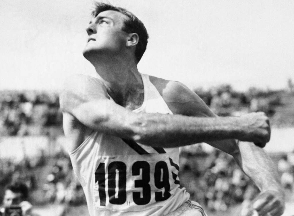 FILE - In this July 26, 1952, file photo, Bob Mathias, defending Olympic decathlon champion, heaves the discus during the decathlon competition at the...