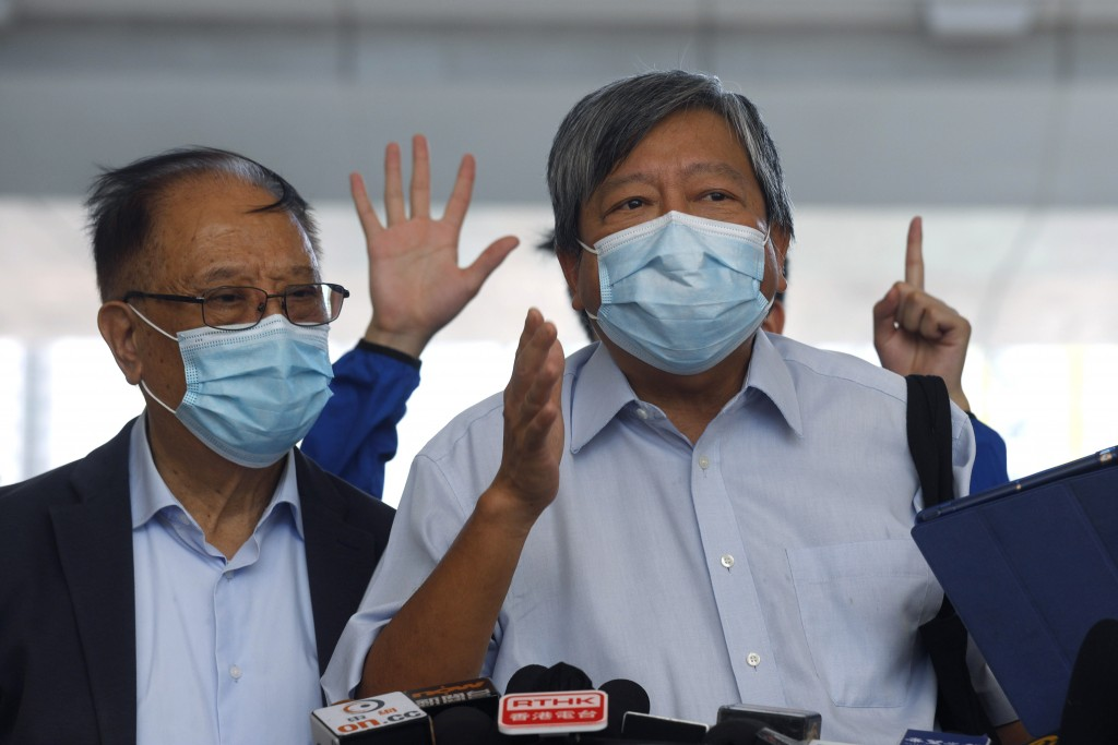 Pro-democracy activists Lee Cheuk-Yan, right, and Yeung Sum speak to media outside a district court in Hong Kong, Thursday, July 30, 2020. Activists i...