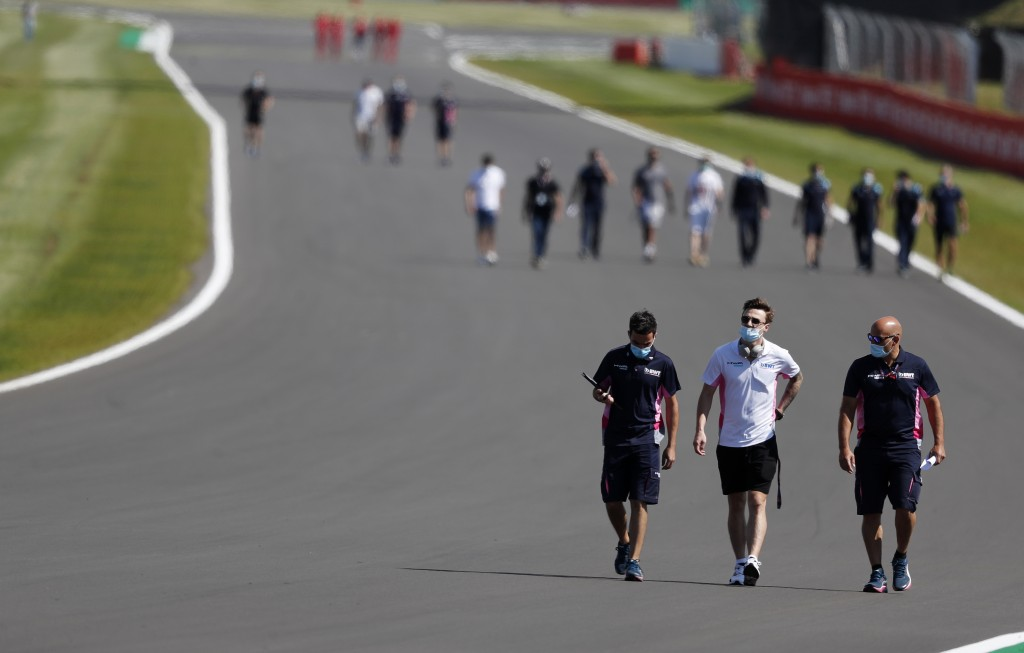 F1 drive hrs walk along the track with team members ahead of the British Formula One Grand Prix at Silverstone circuit, Silverstone, England, Thursday...