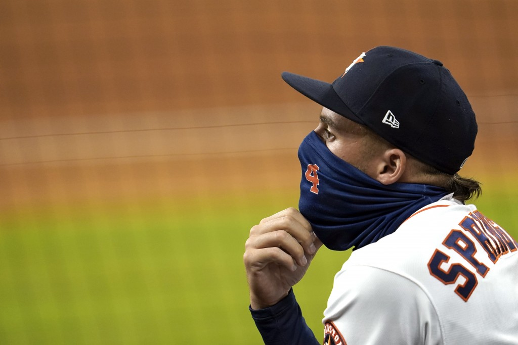 Houston Astros' George Springer watches from the dugout during the fifth inning of a baseball game against the Los Angeles Dodgers Wednesday, July 29,...