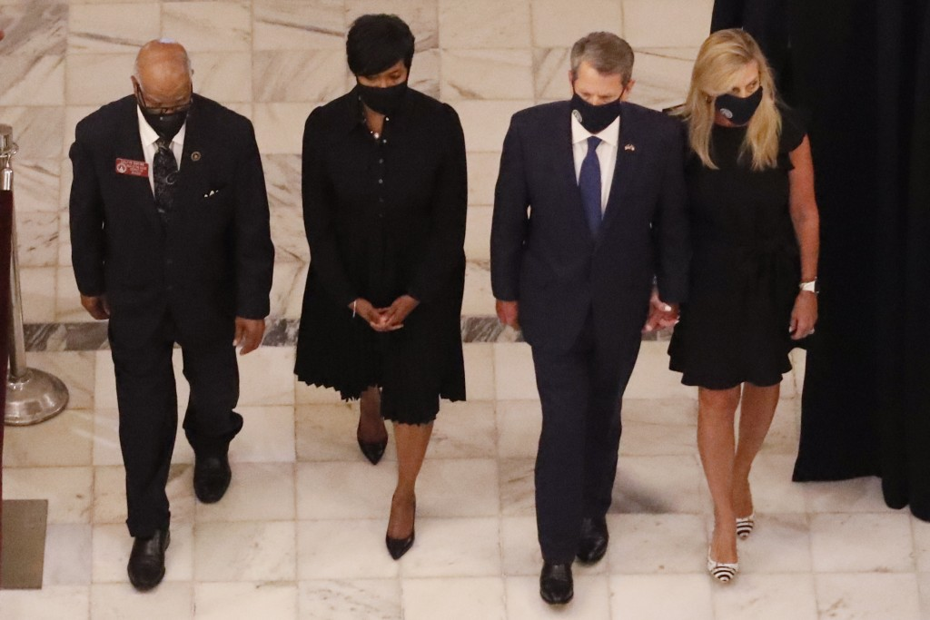 Georgia state Rep. Calvin Smyre, Atlanta Mayor Keisha Lance Bottoms, Gov. Brian Kemp and his wife Marty Kemp, from left, walk ahead of the casket of R...