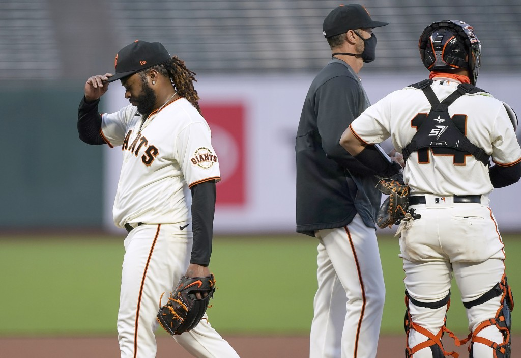 San Francisco Giants pitcher Johnny Cueto, left, is taken out of the game by manager Gabe Kapler, center, during the fourth inning of a baseball game ...