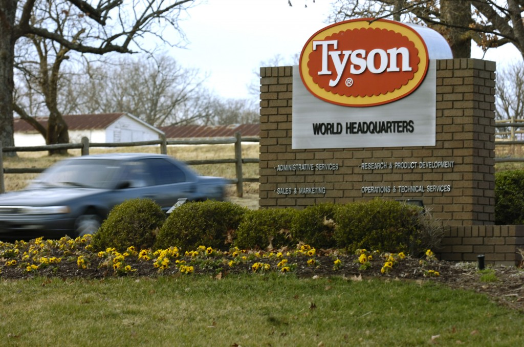 FILE - In this Jan. 29, 2006, file photo, a car passes in front of a Tyson Foods Inc., sign at Tyson headquarters in Springdale, Ark.  Tyson Foods pla...