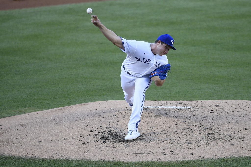 Toronto Blue Jays starting pitcher Nate Pearson delivers a pitch during the third inning of a baseball game against the Washington Nationals, Wednesda...