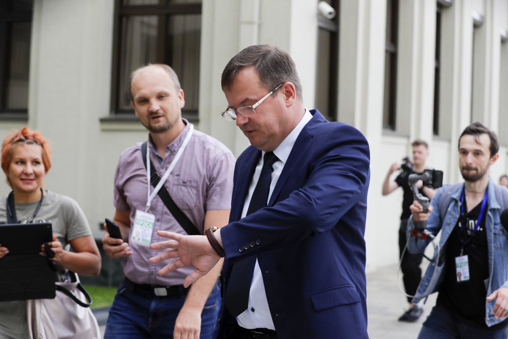 Andrei Ravkov, the head of State Secretary of the Security Council of Belarus looks at his watch as he speaks to the media in Minsk, Belarus, Thursday...
