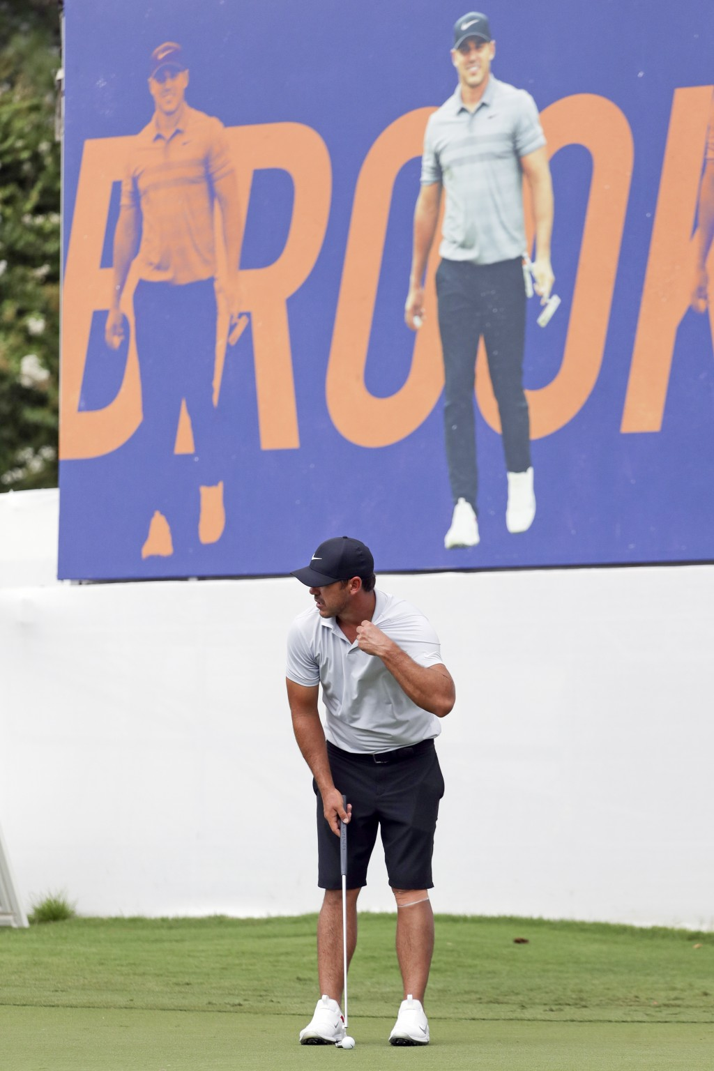 Brooks Koepka putts on the practice green under a banner with his picture at the World Golf Championship-FedEx St. Jude Invitational Wednesday, July 2...