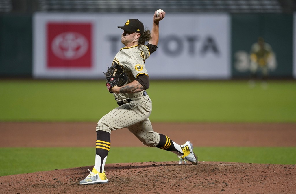 San Diego Padres pitcher Chris Paddack throws against the San Francisco Giants during the fifth inning of a baseball game in San Francisco, Wednesday,...