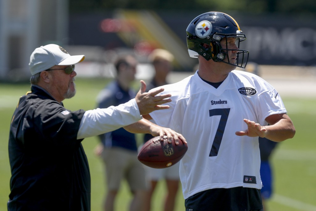 FILE - In this June 11, 2019, file photo, Pittsburgh Steelers quarterback Ben Roethlisberger (7) throws as offensive coordinator Randy Fichtner watche...