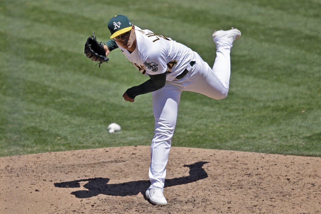 Oakland Athletics pitcher Jesus Luzardo works against the Colorado Rockies in the sixth inning of a baseball game Wednesday, July 29, 2020, in Oakland...