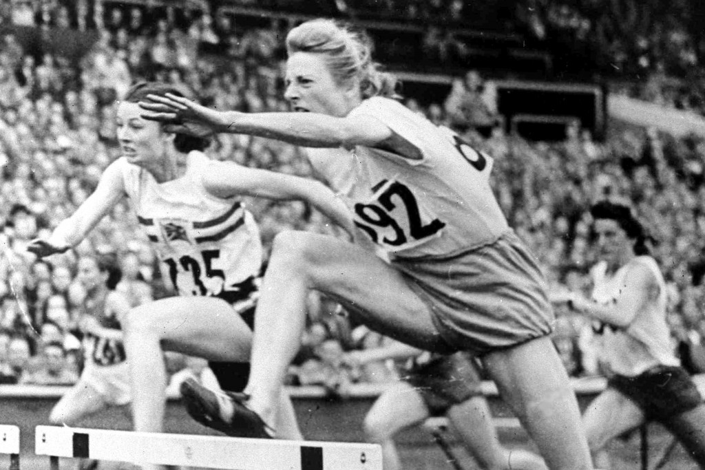 FILE - In this Aug. 4, 1948, file photo, Fanny Blankers-Koen of Holland,, leaps the last hurdle in the women's Olympic Games 80-metres hurdles Final a...