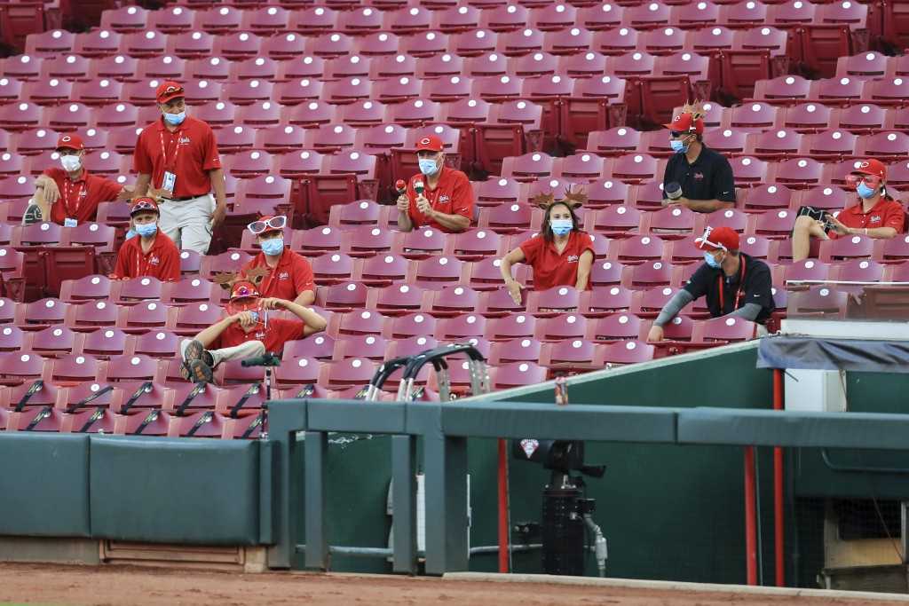 Members of the grounds crew react and make noise from the stands in the fourth inning during a baseball game between the Chicago Cubs and the Cincinna...