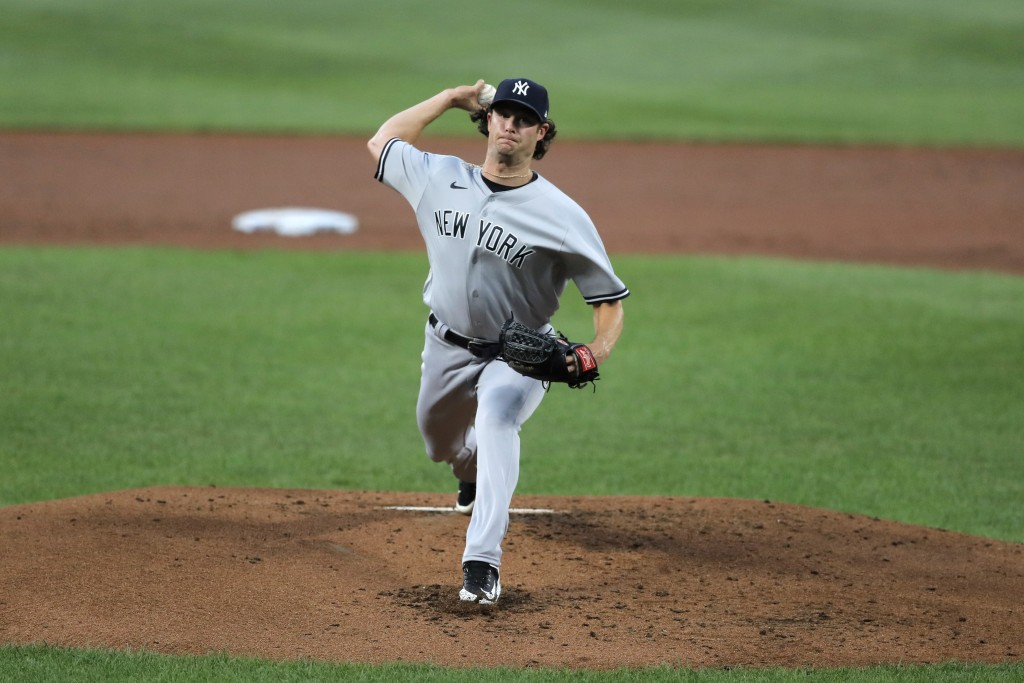 New York Yankees starting pitcher Gerrit Cole throws a pitch to the Baltimore Orioles during the first inning of a baseball game, Wednesday, July 29, ...