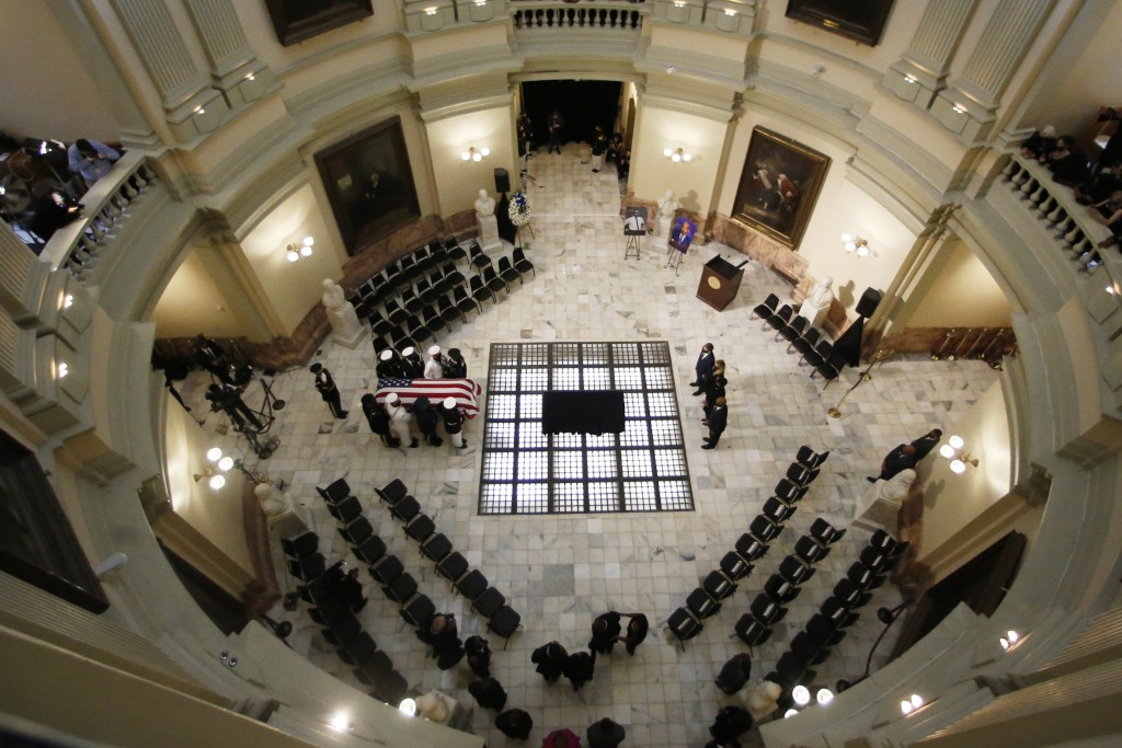 A military honor guard moves with the casket of Rep. John Lewis at the state capital, Wednesday, July 29, 2020, in Atlanta. Lewis, who carried the str...