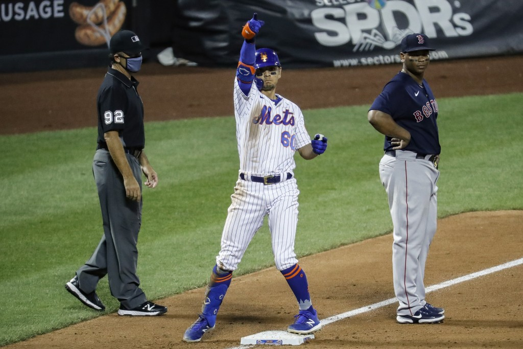New York Mets' Andres Gimenez (60) reacts after hitting an RBI triple off Boston Red Sox relief pitcher Marcus Walden during the sixth inning of a bas...