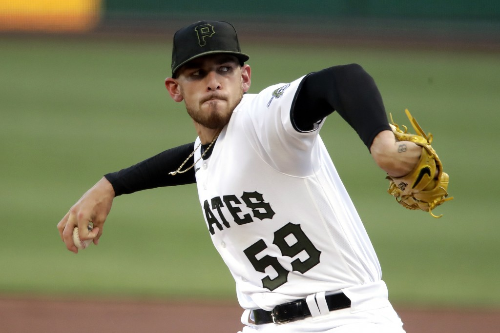 Pittsburgh Pirates starting pitcher Joe Musgrove delivers during the first inning of a baseball game against the Milwaukee Brewers in Pittsburgh, Wedn...